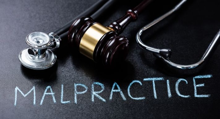 A stock photo for a stethoscope with the word 'Malpractice' written with the frame.